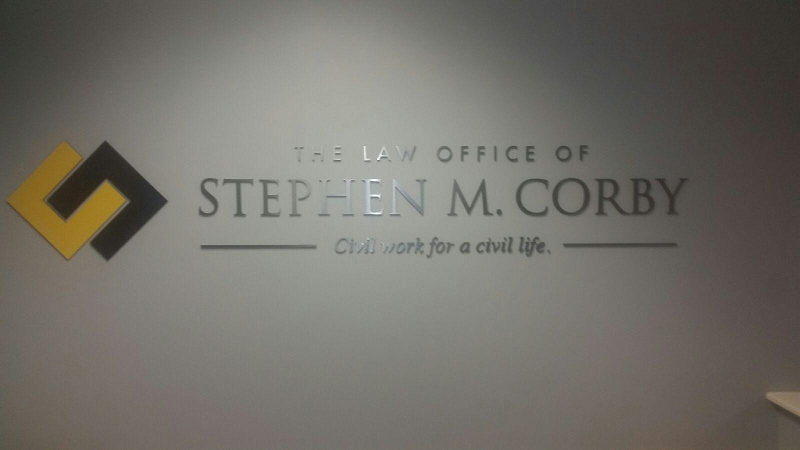 The Law Office of Stephen M. Corby Sign Photograph